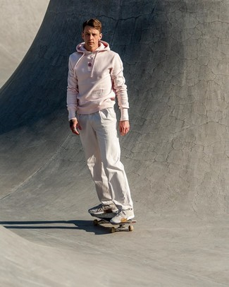 How to wear: pink hoodie, white chinos, grey athletic shoes