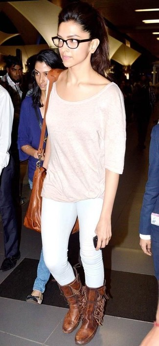 Deepika Padukone wearing Pink Long Sleeve T-shirt, White Skinny Jeans, Brown Leather Mid-Calf Boots, Tobacco Leather Crossbody Bag