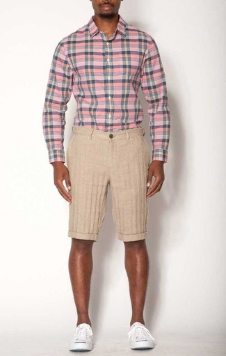 How to Wear Beige Linen Shorts For Men: Go for an off-duty ensemble in a pink plaid long sleeve shirt and beige linen shorts. Add white canvas low top sneakers to this look and the whole ensemble will come together perfectly.