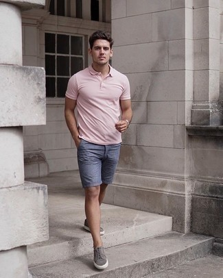 Men's Outfits 2020: This laid-back combo of a pink polo and blue shorts comes in useful when you need to look casually dapper in a flash. Introduce a pair of grey suede low top sneakers to the equation and you're all done and looking boss.