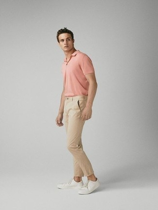 How to Wear a Pink Polo For Men: A pink polo and beige chinos will inject your current fashion mix this relaxed and dapper vibe. A pair of white leather low top sneakers serves as the glue that pulls your ensemble together.