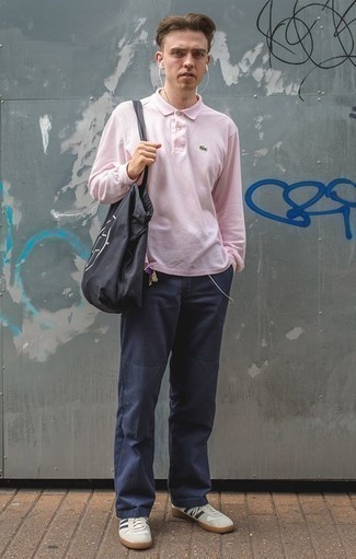 How to Wear a Black and White Print Canvas Tote Bag For Men: A pink polo neck sweater and a black and white print canvas tote bag paired together are a perfect match. Turn up the formality of this outfit a bit by wearing a pair of white and navy leather low top sneakers.
