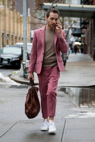 How to Wear a Pink Suit: This is solid proof that a pink suit and a brown crew-neck sweater look awesome when you team them together in a polished look for a modern man. Want to play it down on the shoe front? Add white leather low top sneakers to the equation for the day.
