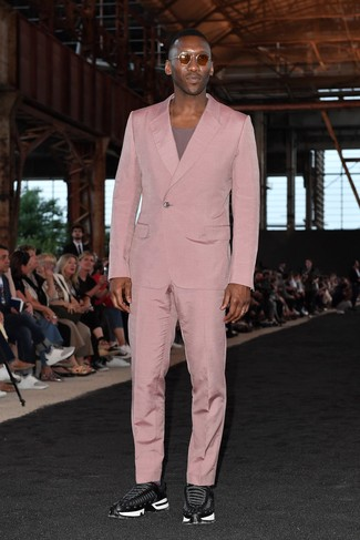 How to wear: pink suit, purple crew-neck t-shirt, black athletic shoes, brown sunglasses