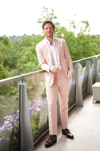 How to wear: pink suit, white long sleeve shirt, dark brown leather oxford shoes, teal socks
