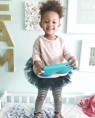 Consider dressing your daughter in a pink sweater with a black tulle skirt for an easy to wear, everyday look. And why not add pink sneakers to the mix?