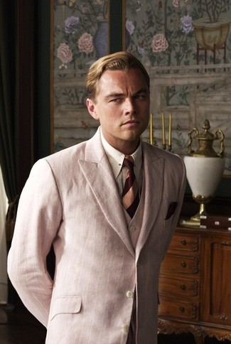 How to wear: pink three piece suit, white vertical striped dress shirt, burgundy horizontal striped tie, burgundy pocket square