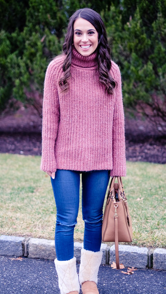 How to wear: pink knit turtleneck, blue ripped skinny jeans, pink uggs, pink leather tote bag