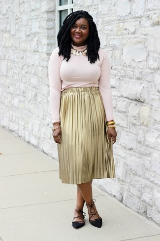 If you like a more casual approach to fashion, why not pair a pink turtleneck with a gold pleated midi skirt? A good pair of Aquazzura Belgravia Lattice Suede Flat Black are sure to leave the kind of impression you want to give. This combination is a wonderful option come spring.