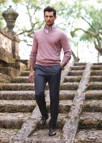 How to Wear Dark Brown Leather Derby Shoes: Consider teaming a pink v-neck sweater with charcoal dress pants for sophisticated style with a modern take. For extra fashion points, complement your outfit with a pair of dark brown leather derby shoes.