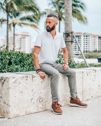Black Beaded Bracelet Outfits For Men: You'll be surprised at how extremely easy it is for any gentleman to put together an edgy outfit like this. Just a white polo and a black beaded bracelet. For a smarter vibe, why not complement your getup with a pair of brown athletic shoes?