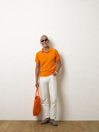 How to Wear an Orange Canvas Tote Bag For Men: This off-duty combo of an orange polo and an orange canvas tote bag is a never-failing option when you need to look dapper in a flash. Finishing with grey suede loafers is a surefire way to add a little classiness to your ensemble.