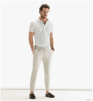 How to Wear a White Polo For Men: You're looking at the hard proof that a white polo and beige chinos look awesome when worn together in a casual outfit. Infuse your look with a dose of refinement by wearing dark brown fringe leather loafers.