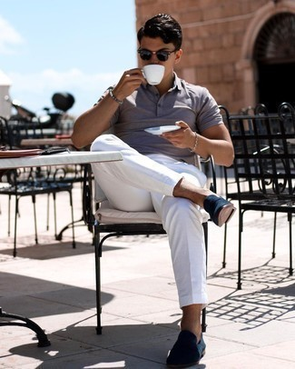 Grey Polo Outfits For Men: This combo of a grey polo and white chinos is indisputable proof that a safe casual getup can still be razor-sharp. Navy suede loafers will introduce a classic aesthetic to the getup.
