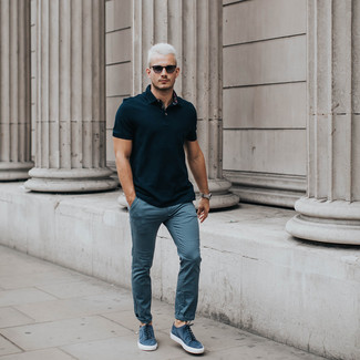 How to wear: black polo, blue chinos, blue suede low top sneakers, black sunglasses