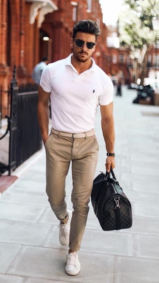 How to wear: white polo, beige chinos, white low top sneakers, black leather holdall