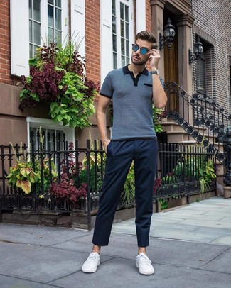 How to wear: navy polo, navy chinos, white low top sneakers, blue sunglasses
