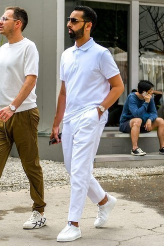 How to Wear a Polo For Men: Marry a polo with white chinos to flaunt your styling smarts. Add white low top sneakers to your ensemble et voila, your look is complete.