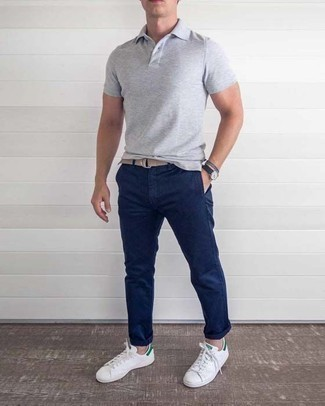 White and Green Leather Low Top Sneakers Outfits For Men: Stand out among other stylish civilians in a grey polo and navy chinos. A pair of white and green leather low top sneakers finishes off this ensemble very well.