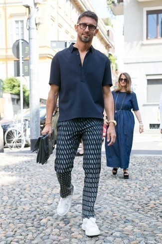 How to Wear a Navy Polo For Men: For a casual look with a fashionable spin, dress in a navy polo and navy print chinos. This look is complemented wonderfully with white and black leather low top sneakers.