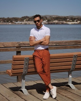 White Polo Outfits For Men: For a laid-back and cool ensemble, dress in a white polo and orange chinos — these two pieces work perfectly well together. White leather low top sneakers work amazingly well here.