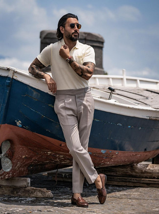 Dark Brown Leather Double Monks Outfits: Master the casually smart ensemble in a beige polo and grey dress pants. For maximum fashion points, complement this look with a pair of dark brown leather double monks.