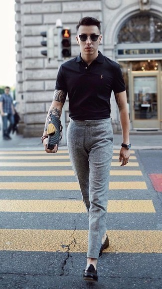How to Wear a Black Polo For Men: When it comes to timeless refinement, this pairing of a black polo and grey wool dress pants never disappoints. Up the ante of your ensemble by finishing with a pair of black leather loafers.