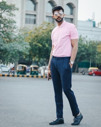 How to Wear a Pink Polo For Men: Pairing a pink polo with navy dress pants is a smart option for a casually neat look. Infuse this ensemble with a touch of elegance by slipping into navy leather monks.