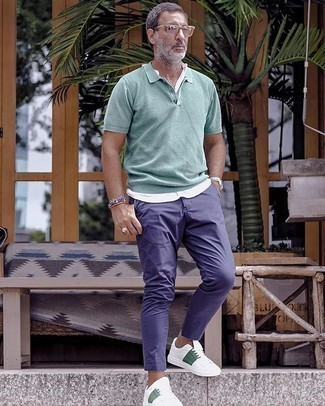 White and Green Canvas Low Top Sneakers Outfits For Men: If you're looking to take your casual style to a new level, wear a mint polo with navy chinos. A pair of white and green canvas low top sneakers serves as the glue that will tie your outfit together.
