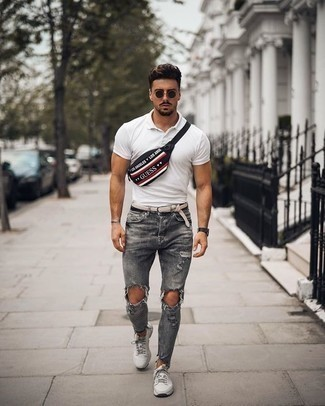 How to Wear Grey Ripped Jeans For Men: Opt for a white polo and grey ripped jeans for relaxed dressing with a bold twist. Grey athletic shoes are a winning footwear style here that's full of personality.