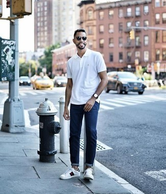 How to Wear Blue Jeans For Men: This combo of a white polo and blue jeans is impeccably stylish and yet it looks functional and ready for anything. Our favorite of a ton of ways to finish this ensemble is white print leather low top sneakers.