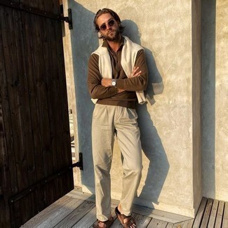 Sandals Outfits For Men: Pairing a brown polo neck sweater with beige chinos is a good option for an effortlessly neat getup. And it's a wonder what sandals can do for the outfit.