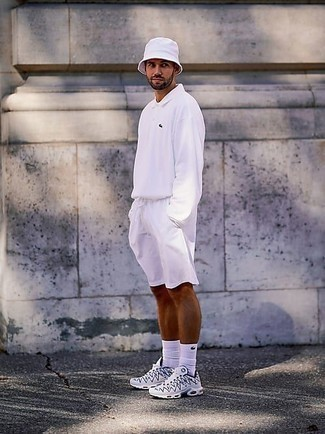 How to Wear a Polo Neck Sweater For Men: You'll be surprised at how easy it is for any man to get dressed like this. Just a polo neck sweater paired with white sports shorts. Add white and navy athletic shoes to the equation to give a sense of stylish casualness to this look.