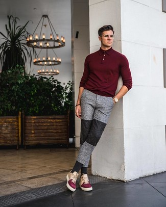 How to Wear a Burgundy Polo Neck Sweater For Men: You'll be amazed at how extremely easy it is for any man to pull together this relaxed casual getup. Just a burgundy polo neck sweater and grey sweatpants. For something more on the relaxed end to finish off this getup, introduce multi colored leather low top sneakers to the mix.