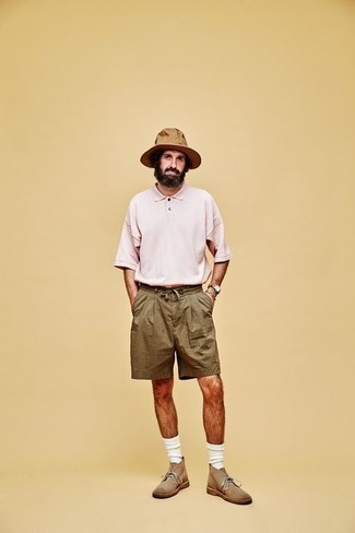 How to Wear a Pink Polo For Men: If you're looking for a laid-back yet on-trend ensemble, opt for a pink polo and olive shorts. For something more on the dressier end to complement your ensemble, complement this look with a pair of tan suede desert boots.