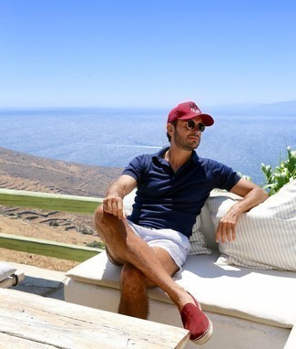 Navy Polo Outfits For Men: This combo of a navy polo and white and blue print shorts is extremely easy to create and so comfortable to wear over the course of the day as well! Finishing with a pair of burgundy suede espadrilles is a surefire way to breathe a hint of elegance into your outfit.