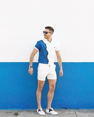 How to wear: white and navy polo, white shorts, white low top sneakers, navy sunglasses