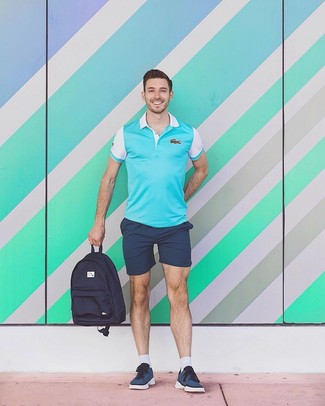 How to wear: aquamarine polo, navy shorts, navy low top sneakers, navy canvas backpack