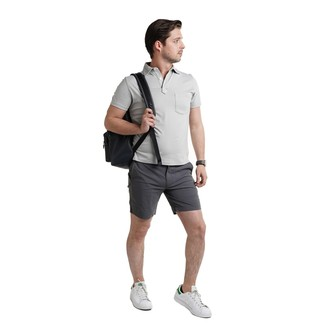 How to wear: grey polo, charcoal shorts, white leather low top sneakers, black leather backpack