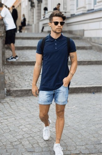 How To Wear Light Blue Denim Shorts With White Sneakers In Your 20s For Men: A navy polo and light blue denim shorts are essential in any modern gent's well-balanced off-duty arsenal. Don't know how to finish? Introduce a pair of white sneakers to this outfit for a more relaxed take.