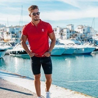 How to Wear Denim Shorts For Men: A red polo and denim shorts are an off-duty combination that every trendsetting gent should have in his off-duty fashion mix. A pair of white canvas low top sneakers will pull your whole outfit together.