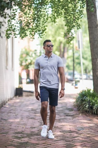 How to Wear Navy Sunglasses For Men: If you prefer casual looks, why not wear this pairing of a grey polo and navy sunglasses? Rounding off with a pair of white canvas low top sneakers is a fail-safe way to introduce a bit of classiness to this ensemble.