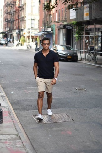 How to Wear Beige Shorts For Men: Inject style into your daily off-duty fashion mix with a navy polo and beige shorts. The whole getup comes together if you add a pair of white canvas low top sneakers to the equation.