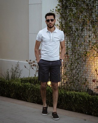 Shorts Outfits For Men: A white polo and shorts are a great combo that will carry you throughout the day and into the night. Black canvas slip-on sneakers are a smart option to round off this getup.
