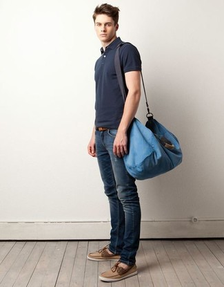 How to wear: charcoal polo, navy ripped skinny jeans, tan suede boat shoes, blue canvas duffle bag