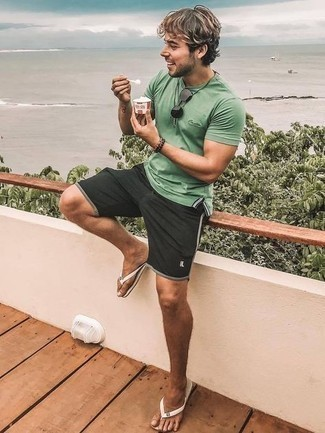 Bracelet Outfits For Men: If you like comfort dressing, opt for a mint polo and a bracelet. Bring a more casual twist to this outfit by rounding off with white rubber flip flops.