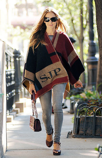 How to wear: multi colored poncho, white and black horizontal striped crew-neck sweater, grey skinny jeans, burgundy leather heeled sandals