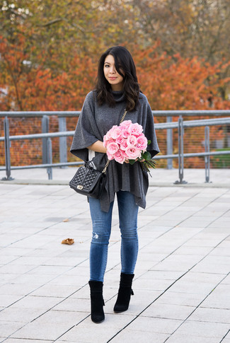 How to wear: charcoal wool poncho, white crew-neck t-shirt, blue ripped skinny jeans, black suede ankle boots