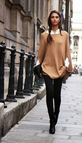 Marry a camel poncho with a black suede clutch to effortlessly deal with whatever this day throws at you. Look at how well this getup is complemented with black leather ankle boots. Sunnier days call for lighter combos like this one.