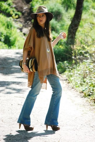 If the situation permits casual styling, reach for a tan poncho and light blue flare jeans. Want to go all out on the shoe front? Introduce dark brown leather heeled sandals to your outfit.